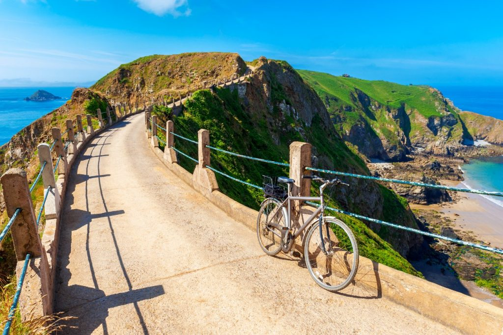 Bicycle parked on Isthmus on Sark, Channel Islands, UK