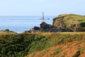 The historic stone lighthouse on Chicken Rock south of Calf of Man island, Isle of Man