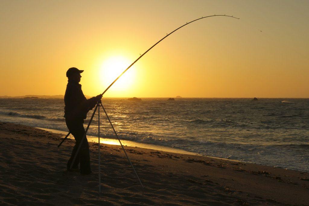 Fisherman at Alderney beach