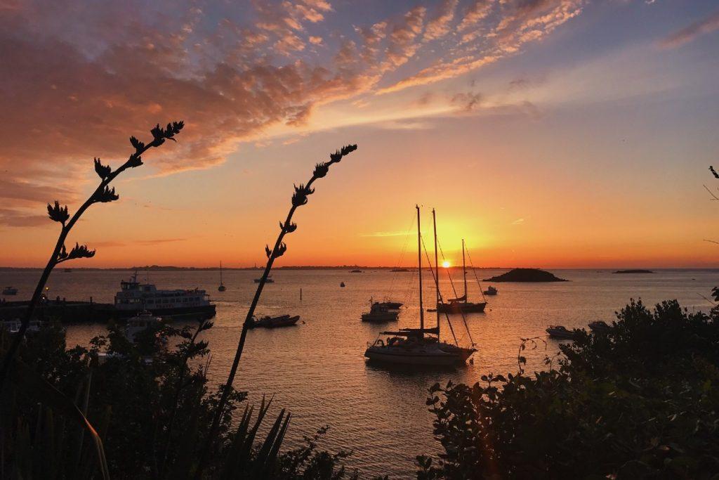 Seaside sunset nearby Herm island